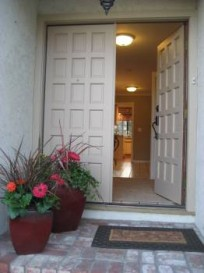 Have happy greeters at the front door of colorful flowers