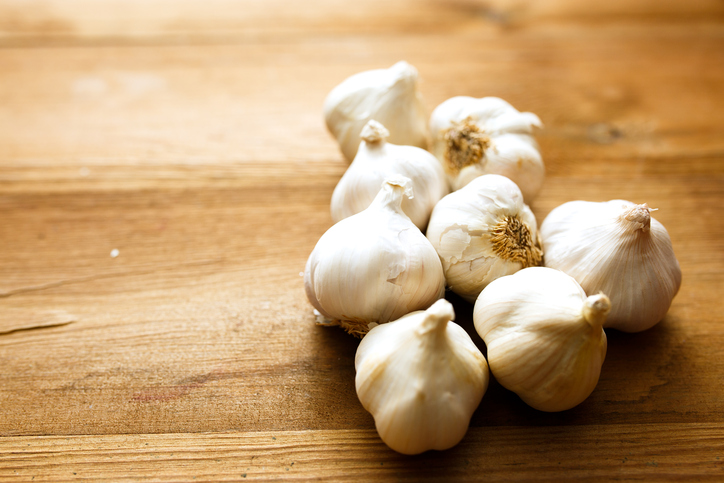 Fresh garlic bulbs on wood