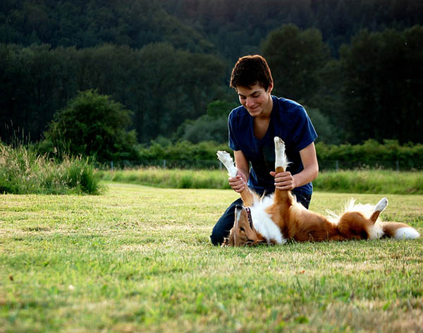 11 Reasons You Should Date a Dog Owner - man playing with dog