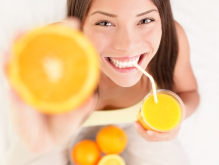 girl eating oranges and juice care2 healthy living