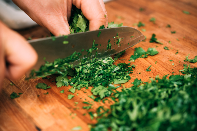 Cutting parsley in a kitchen.