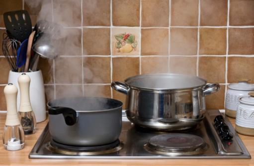 Pans boiling in a kitchen