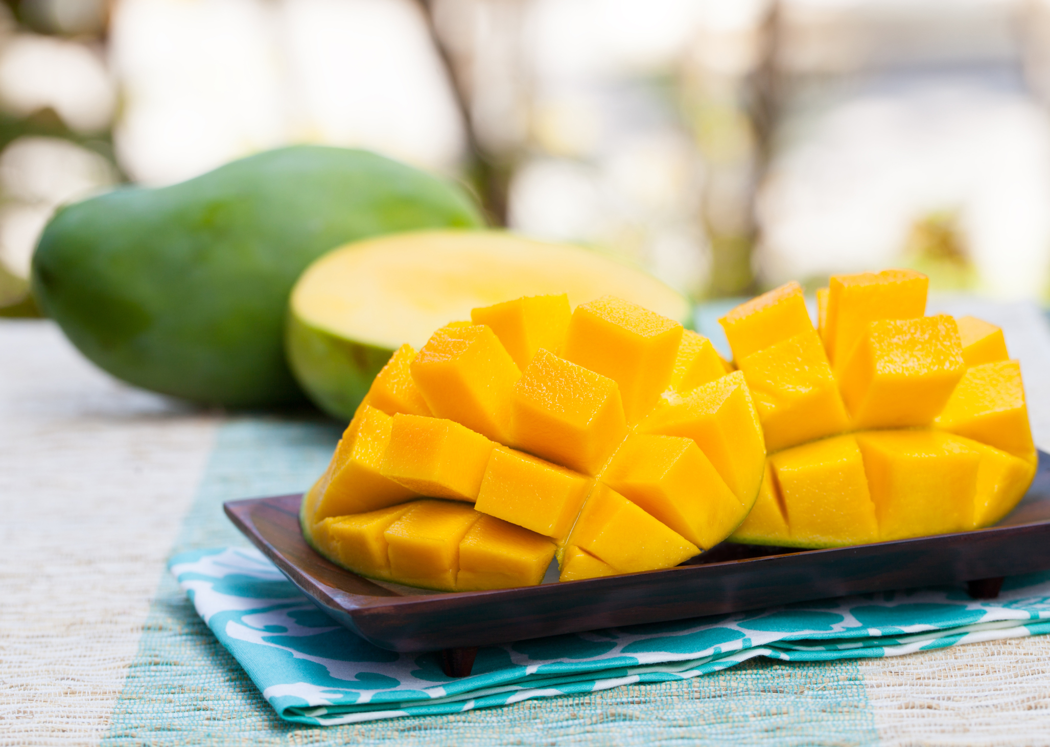Fresh mango organic product on a tropical outdoor background