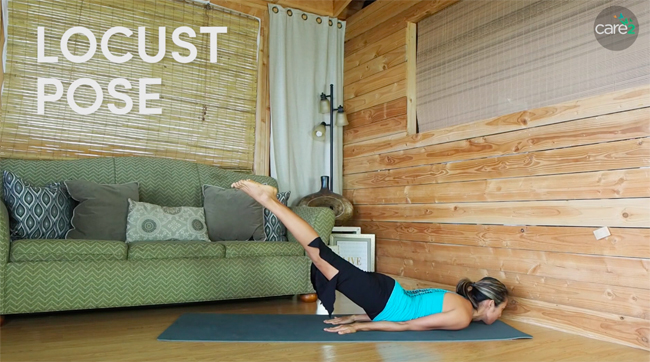 In locust pose, you lie on your stomach and lift your legs up toward the ceiling. This helps strengthen your back muscles.