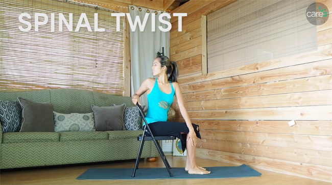 This variation of a spinal twist uses a chair, and is a great back exercise for people at the office.