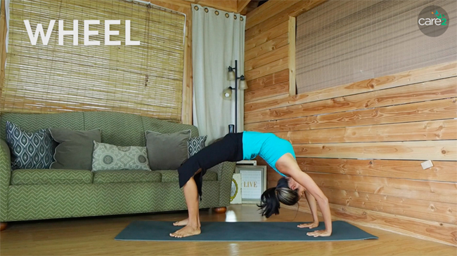 To do wheel pose, lie on your back, bending your knees and your elbows. Pressing your hands and your palms in the ground, push your tailbone and butt off the ground. Check with your doctor before incorporating wheel pose if you are new to exercise.