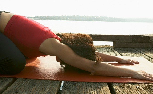 Child's Pose is a restorative pose that can help with neck pains and fatigue.