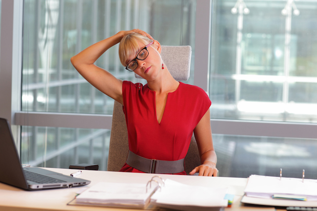 This is a great neck stretch that you can do anywhere. Sit or stand up straight with your chin in a neutral position and your shoulders pressed down. Gently tilt your head to the left, so your left ear drops toward your left shoulder; it will not touch. Keep your chin tilted up slightly, then use your left hand to very gently pull your head closer to your shoulder. Do not pull hard, and if you feel pain, ease off on the pressure. Hold this for 5-10 seconds, then come back to neutral and repeat on the other side. You can do 3-5 sets of this exercise.
