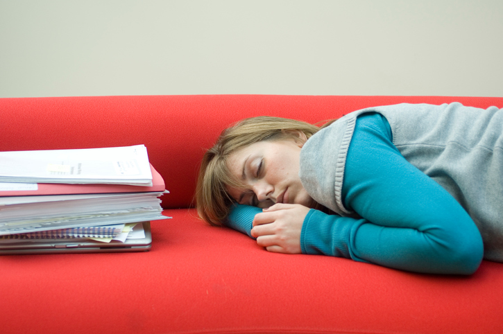 Mid adult woman sleeping on a couch