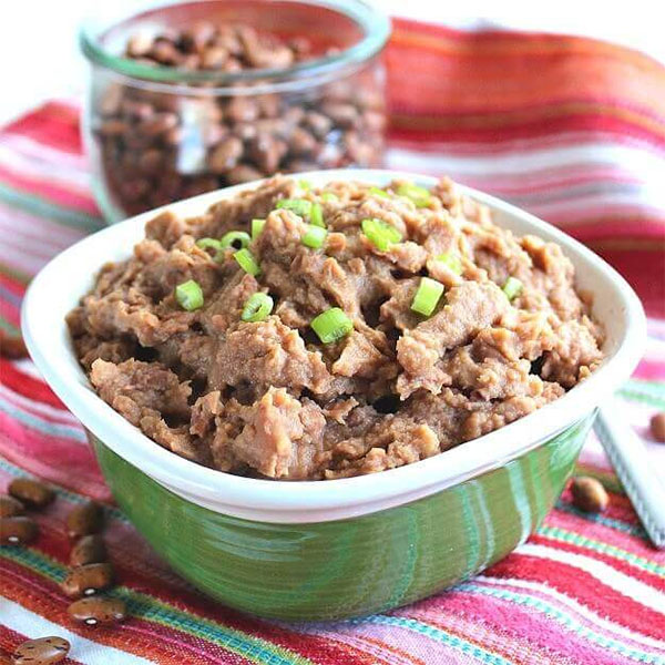 Refried beans are a classic taco filling, and you can make them in the slow cooker!