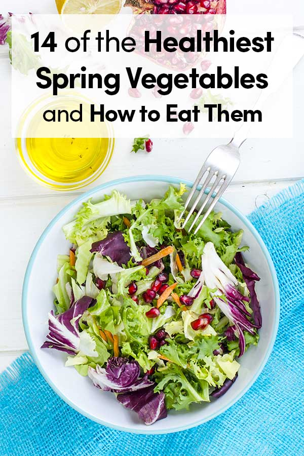 Fresh green salad with spring veggies and pomegranate