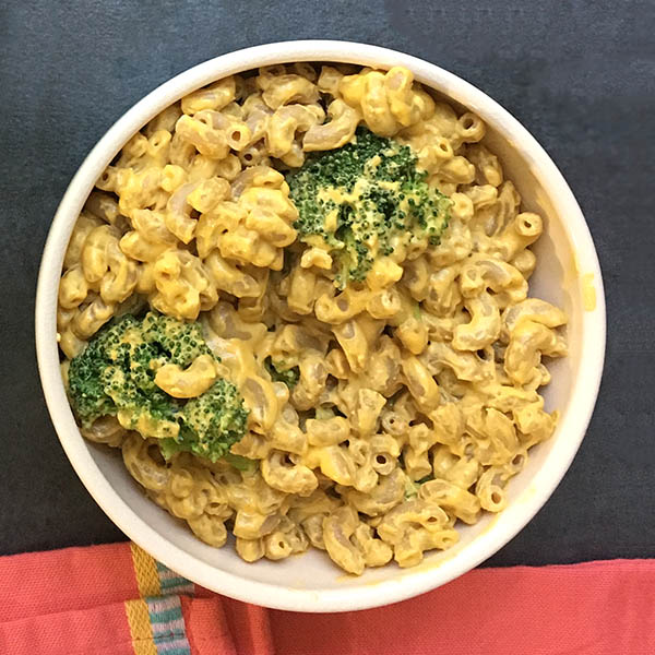 Vegan macaroni and cheese with broccoli is a rich and creamy bowl of comfort food. My family calls it Mac and Trees!
