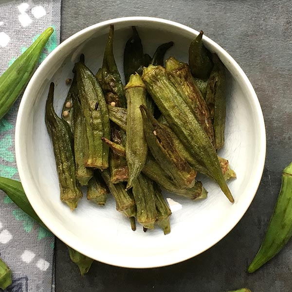 Whole Roasted Okra is simple to prepare and requires very little active cooking time. Roasting turns okra into a tender, tasty side dish without the stringiness that you associate with boiled okra.