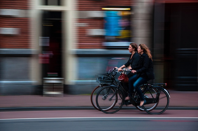 two people riding bicycles