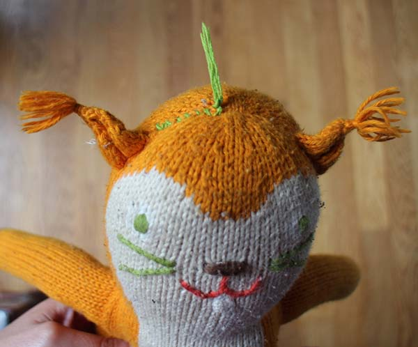 Use a whipstitch to mend a toy.