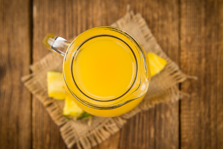 Fresh made Pineapple Juice on a rustic background