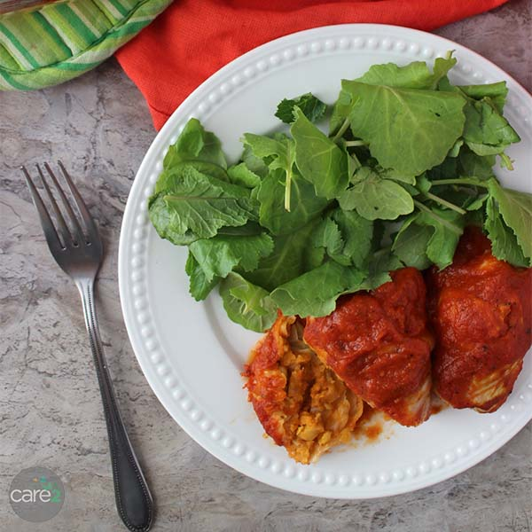 Vegan Baked Cabbage Rolls stuffed with flavorful chickpeas, topped with tomato sauce, and baked to perfection in the oven.