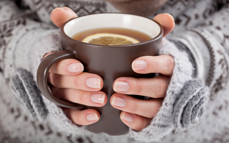Woman hands with hot drink