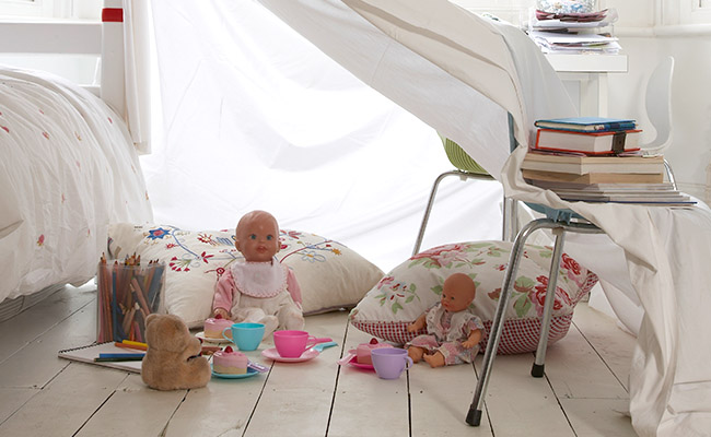 Child's room with a blanket fort.
