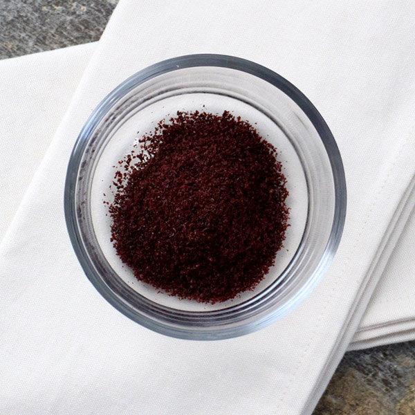 bowl of sumac on a white napkin