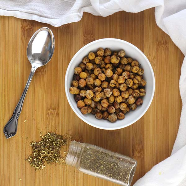 These tangy, tasty Za'atar Roasted Chickpeas use a secret ingredients to get those delicious spices to stick. The best part? The secret ingredient is free!