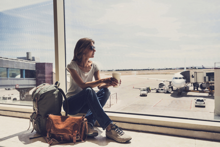 Young woman waiting for a plane. Travel concept