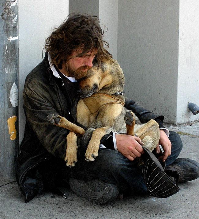 Homeless Man Holding his Dog