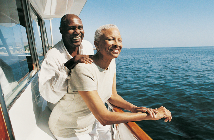 Senior Couple Standing on Deck on a Boat Looking at the View