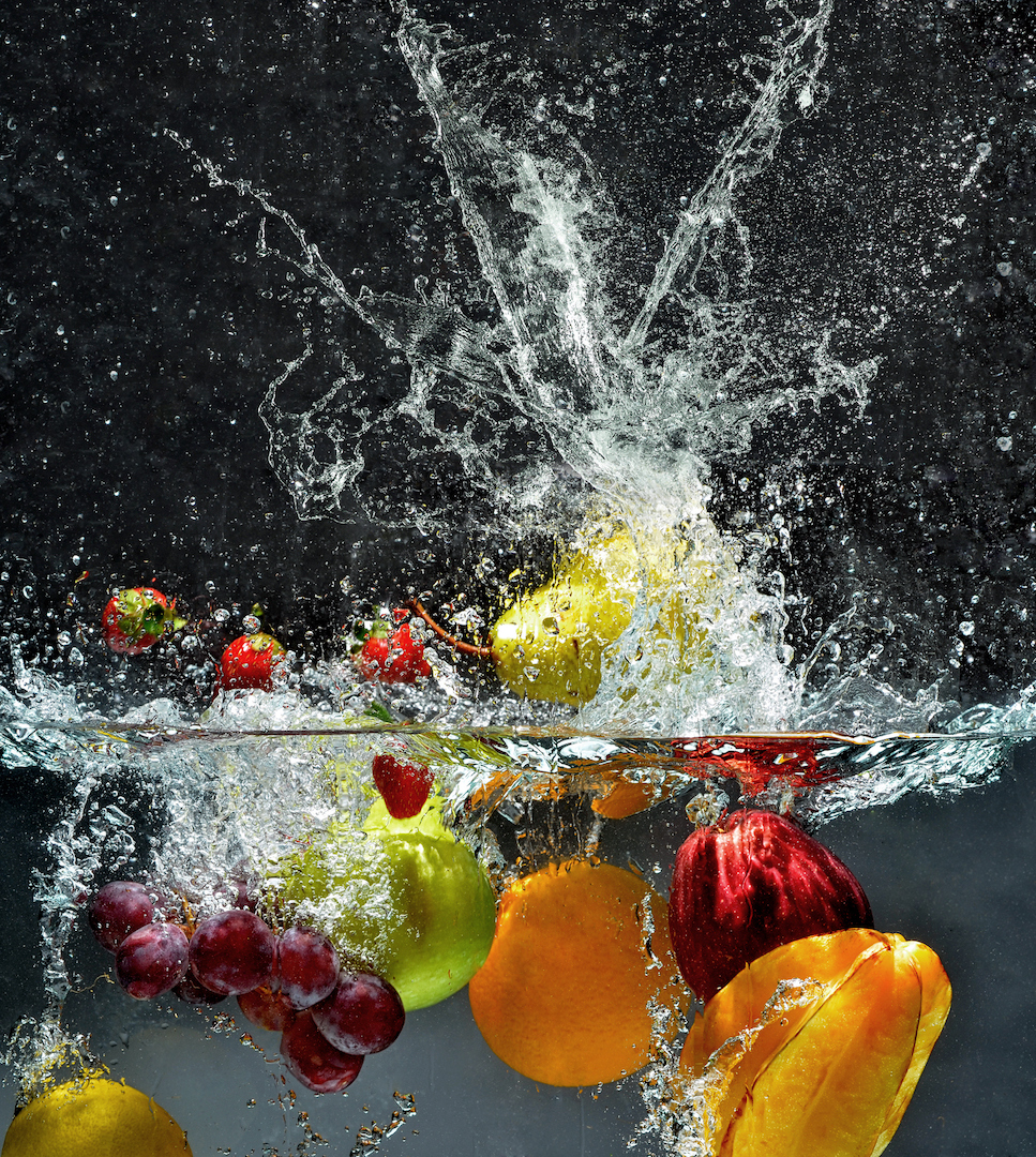 Fresh fruits and vegetables falling into water