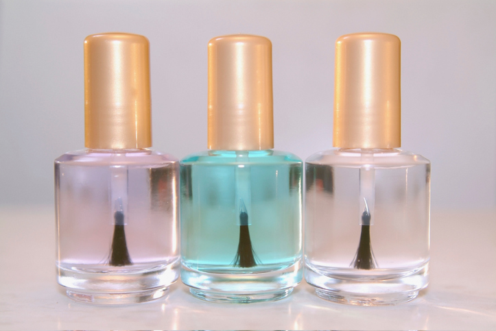 Close-up of three bottles of clear nail polish