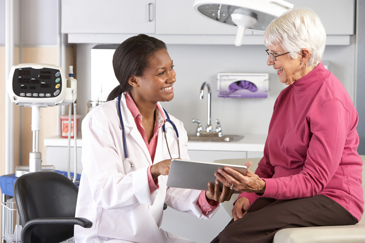 Doctor discussing records with senior patient