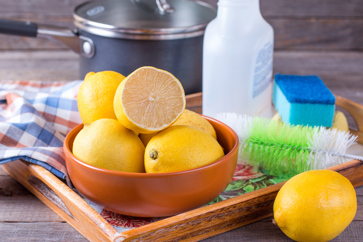 Ingredients for a natural cleaner, including lemons and vinegar