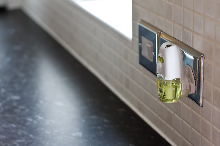 an air freshener plugged into a wall socket in a kitchen