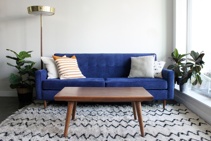 a blue couch in a living room