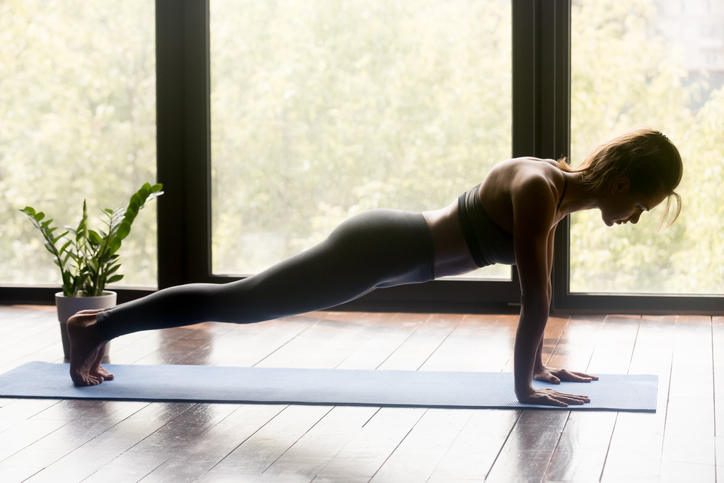 Young sporty woman doing pilates, fitness or yoga Plank pose