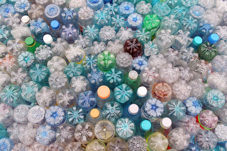 Dirty used colored plastic bottle pile