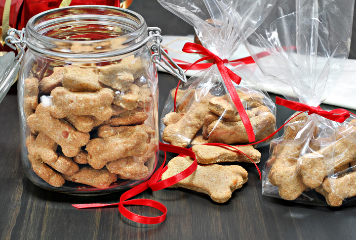 Homemade dog bones packaged into bags and a jar