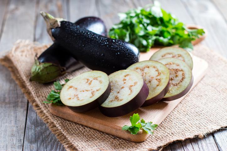 Sliced eggplant on wooden cutting board