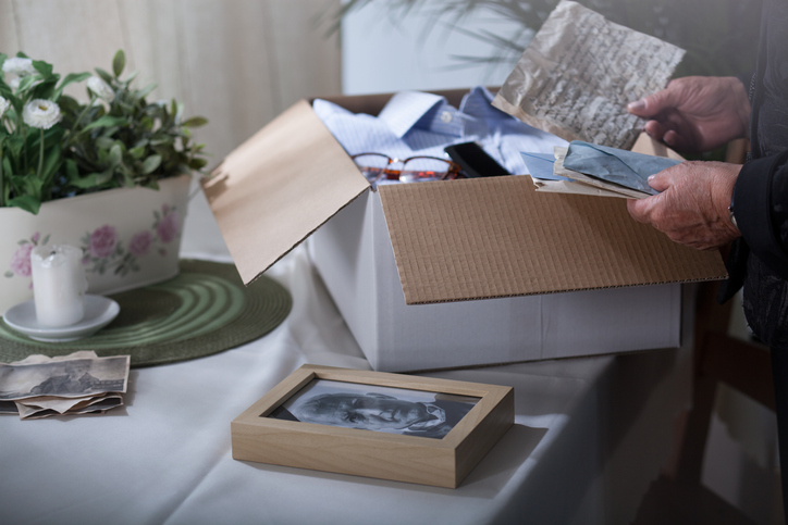 a memory box of photographs, letters and other items
