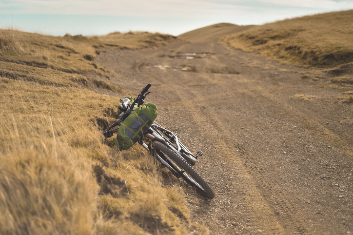 Autumn mountain scene riding with a mountain bike equipped with travel bags