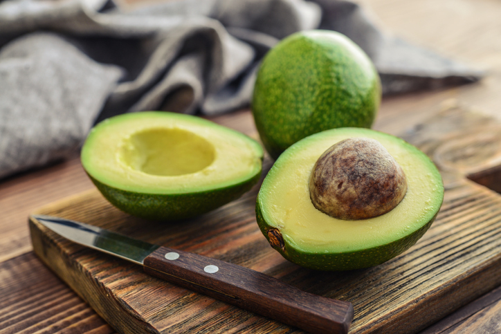 Fresh avocado on a cutting board