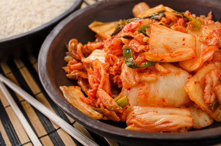 A bowl of traditional Korean napa kimchi with white rice