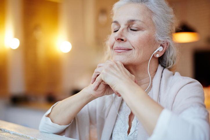 woman relaxing and listening to music with headphones