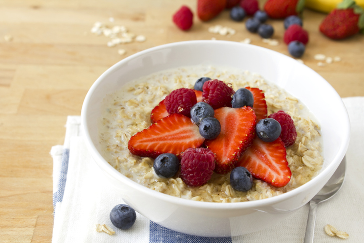 A bowl of healthy oatmeal with fresh berries