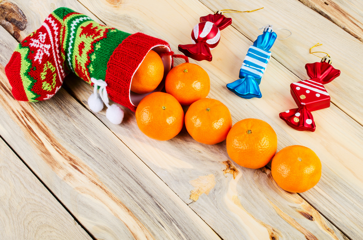 oranges coming out of a Christmas stocking
