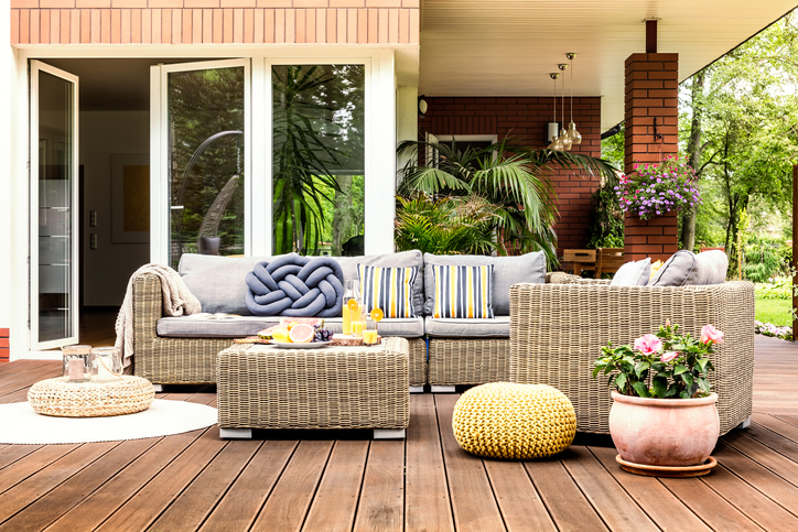 a deck with comfortable furniture