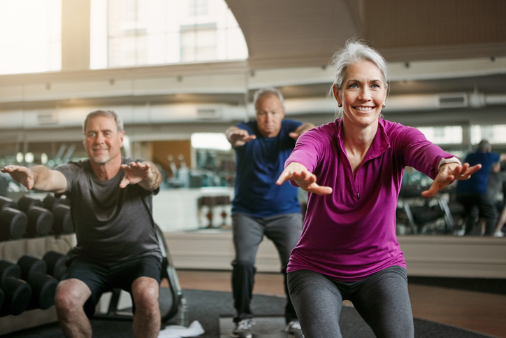 Shot of a senior group of woman and men working out together at the gym
