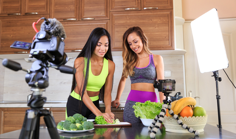 Young friends vlogger recording a healthy eating video for theirs vlog