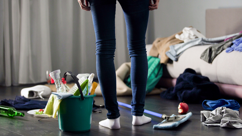 woman standing in front of clutter
