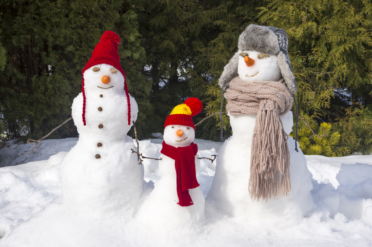 three snowmen with hats and scarves